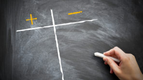 Pro's and con's graph on a blackboard with a person holding chalk